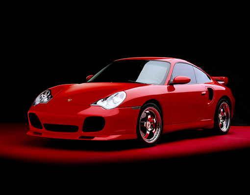 POR 03 RK0133 06 © Kimball Stock 2003 Porsche Turbo X50 Red Front 3/4 View On Red Floor Studio