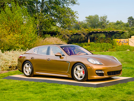 POR 04 BK0002 01 © Kimball Stock 2013 Porsche Panamera Turbo Bronze 3/4 Front View On Grass