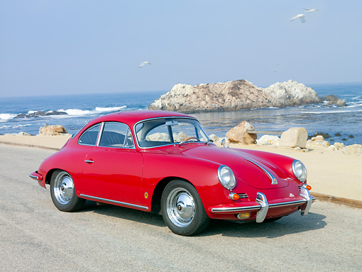 POR 04 BK0003 01 © Kimball Stock 1962 Porsche 356B Coupe Red 3/4 Front View On Pavement By Ocean