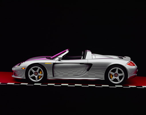 POR 04 RK0572 03 © Kimball Stock 2004 Porsche Carrera GT Silver Profile On Checkered Line Red Floor Studio