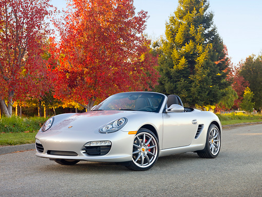 POR 04 RK0844 01 © Kimball Stock 2010 Porsche Boxster S Convertible Silver 3/4 Front View On Pavement By Autumn Trees