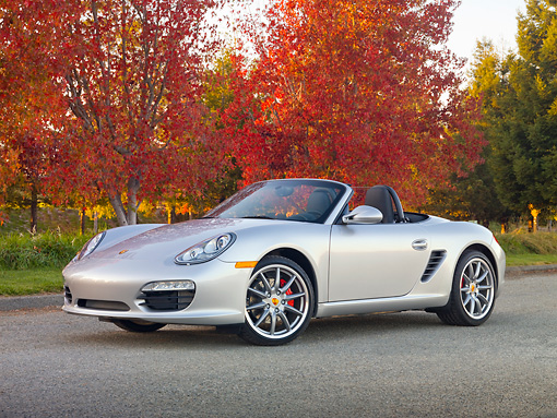 POR 04 RK0845 01 © Kimball Stock 2010 Porsche Boxster S Convertible Silver 3/4 Front View On Pavement By Autumn Trees