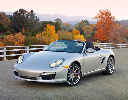 POR 04 RK0853 01 © Kimball Stock 2010 Porsche Boxster S Convertible Silver 3/4 Front View On Pavement