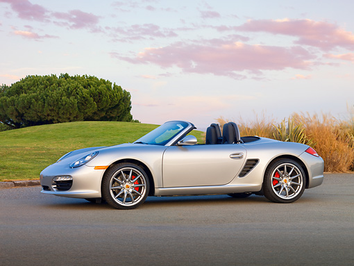 POR 04 RK0854 01 © Kimball Stock 2010 Porsche Boxster S Convertible Silver Profile View On Pavement
