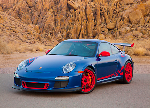 POR 04 RK0904 01 © Kimball Stock 2011 Porsche GT3 RS Blue And Red 3/4 Front View On Pavement