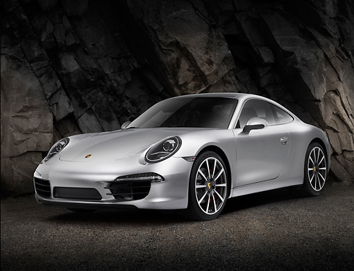 POR 04 RK0939 01 © Kimball Stock 2012 Porsche 911 Carrera S Silver 3/4 Front View On Pavement By Rock Wall