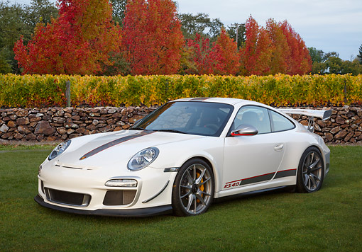 POR 04 RK0942 01 © Kimball Stock 2012 Porsche 911 GT3 RS White 3/4 Front View On Grass By Autumn Trees