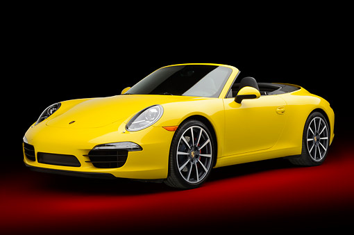 POR 04 RK0948 01 © Kimball Stock 2013 Porsche 911 Carrera S Cabriolet Yellow 3/4 Front View In Studio
