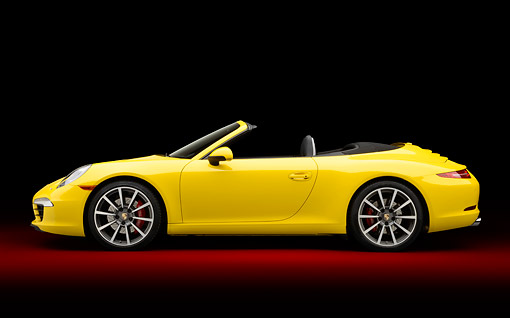 POR 04 RK0949 01 © Kimball Stock 2013 Porsche 911 Carrera S Cabriolet Yellow Profile View In Studio