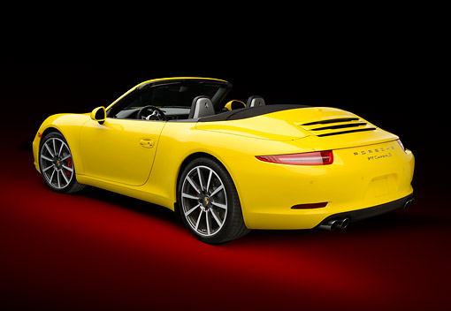 POR 04 RK0950 01 © Kimball Stock 2013 Porsche 911 Carrera S Cabriolet Yellow 3/4 Rear View In Studio