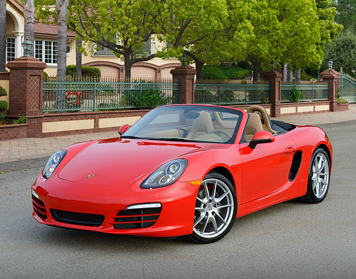 POR 04 RK0959 01 © Kimball Stock 2013 Porsche Boxster Red 3/4 Front View On Pavement By Gated House