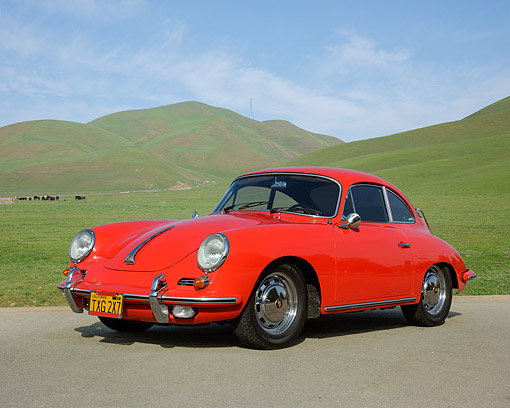 POR 04 RK0976 01 © Kimball Stock 1962 Porsche 356B Coupe Red 3/4 Front View On Pavement By Grassy Hills