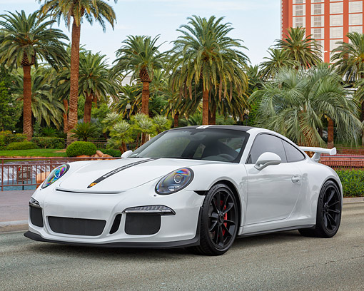 POR 04 RK0985 01 © Kimball Stock 2015 Porsche GT3 White 3/4 Front View By Palm Trees And Swanky Hotel