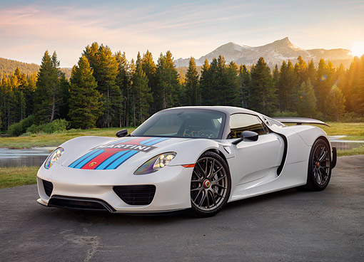 POR 04 RK0998 01 © Kimball Stock 2015 Porsche 918 Martini Weissach Edition Hybrid Supercar 3/4 Front View In Forest Meadow At Sunset