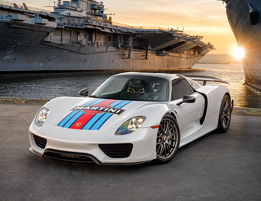 POR 04 RK0999 01 © Kimball Stock 2015 Porsche 918 Martini Weissach Edition Hybrid Supercar 3/4 Front View By Aircraft Carriers At Sunset