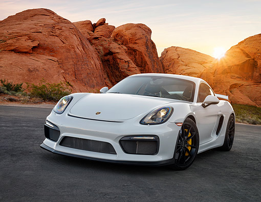 POR 04 RK1000 01 © Kimball Stock 2016 Porsche GT4 White 3/4 Front View In Desert At Sunset