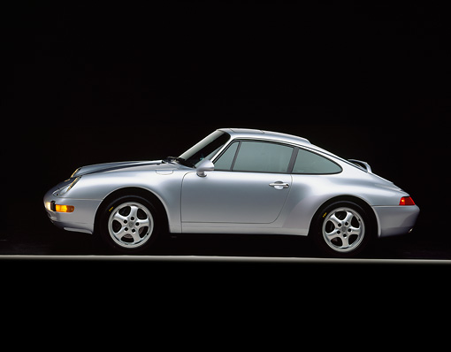 POR 04 RK0003 02 © Kimball Stock 1995 Porsche 993-C2 Carrera Coupe Silver Profile View On Gray Line Studio
