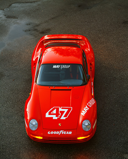 POR 04 RK0029 18 © Kimball Stock 1988 Porsche 959S Red Overhead Front On Pavement