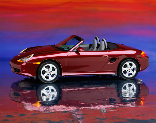 POR 04 RK0092 10 © Kimball Stock 1997 Porsche Boxster Convertible Burgundy 3/4 Front View On Mylar Floor Studio