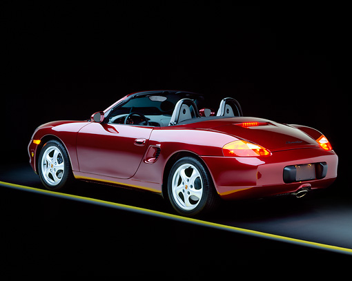 POR 04 RK0093 02 © Kimball Stock 1997 Porsche Boxster Convertible Burgundy 3/4 Rear View Studio