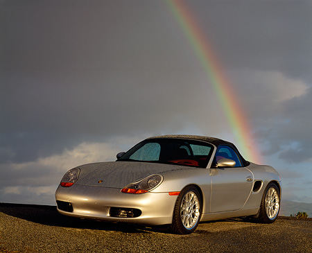 POR 04 RK0196 05 © Kimball Stock 1998 Porsche Boxster Convertible Silver 3/4 Front View On Pavement Rainbow Background