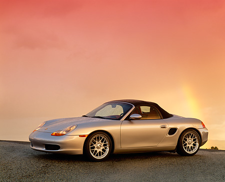 POR 04 RK0197 05 © Kimball Stock 1998 Porsche Boxster Convertible Silver 3/4 Side View On Pavement Filtered
