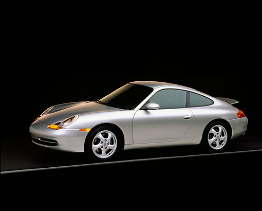 POR 04 RK0356 02 © Kimball Stock 1999 Porsche 911 Carrera Coupe Silver (996) 3/4 Side View on black with gray line in studio rear spoiler up