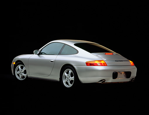 POR 04 RK0362 01 © Kimball Stock 1999 Porsche 911 Carrera Coupe Silver 3/4 Rear View Studio
