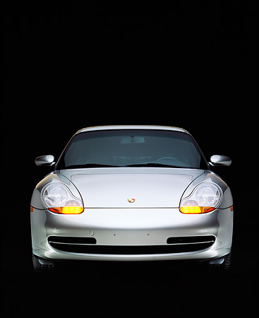 POR 04 RK0367 03 © Kimball Stock 1999 Porsche 911 Carrera Coupe Silver Head On Studio