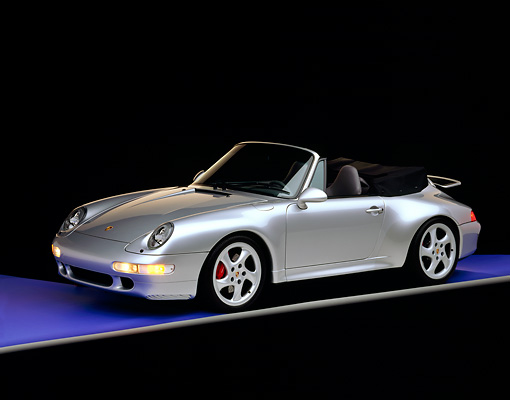 POR 04 RK0374 02 © Kimball Stock 1997 Porsche 993 Cabriolet Turbo Silver 3/4 Side View Blue Floor Studio
