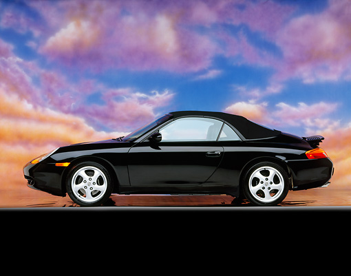 POR 04 RK0375 01 © Kimball Stock 1999 Porsche 996 Cabrio Black Profile On Gray Line Spoiler Up Pink Clouds Background