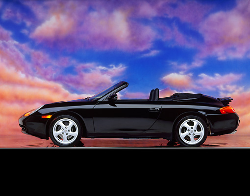 POR 04 RK0378 08 © Kimball Stock 1999 Porsche 996 Convertilbe  Black Profile Pink Clouds Studio