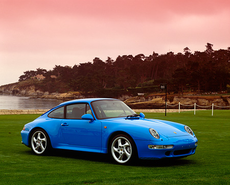 POR 04 RK0389 01 © Kimball Stock 1998 Porsche 911 Carrera (Last One Built) 3/4 Side View On Grass