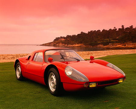 POR 04 RK0392 13 © Kimball Stock 1964 Porsche GTS 904 Red Front 3/4 View On Grass By Water Filtered