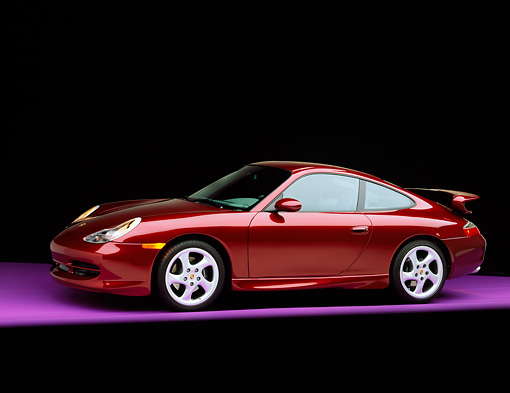 POR 04 RK0403 05 © Kimball Stock 1999 Porsche 996 Carrera Arena Red 3/4 Front View On Purple Floor Studio