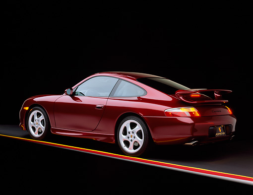 POR 04 RK0404 07 © Kimball Stock 1999 Porsche 996 Carrera Arena Red 3/4 Rear View Studio