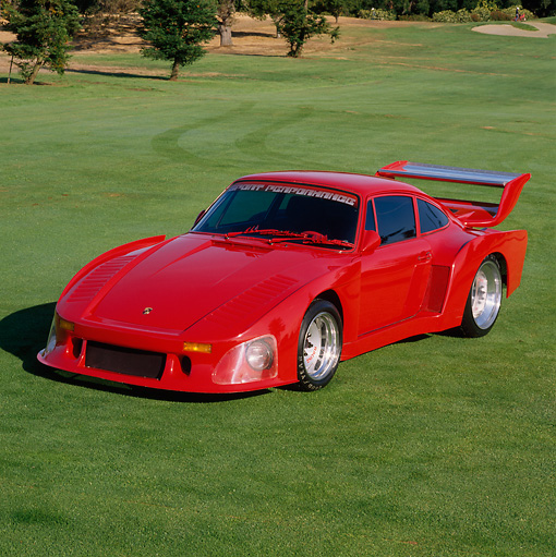 POR 04 RK0413 13 © Kimball Stock Porsche Turbo with Kramer 935 Body Red 3/4 Front View On Grass