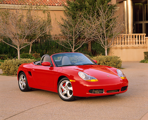 POR 04 RK0419 02 © Kimball Stock 2000 Porsche Boxster S Convertible Red 3/4 Front View In Front Of Museum