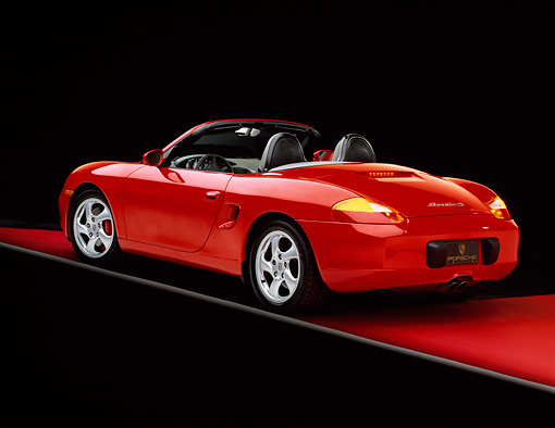 POR 04 RK0427 02 © Kimball Stock 2000 Porsche Boxster S Convertible Red 3/4 Rear View On Red Floor Studio