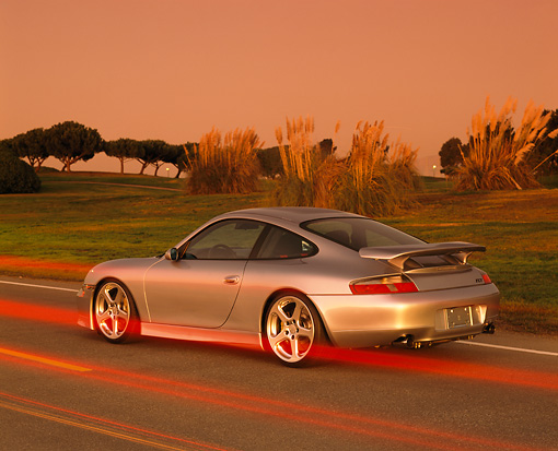POR 04 RK0450 01 © Kimball Stock 2001 Porsche RUF RGT Silver Rear 3/4 View With Special Effects On Pavement