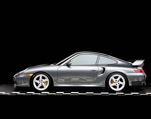 POR 04 RK0476 03 © Kimball Stock 2002 Porsche GT2 Gray Profile On Checkered Line Studio