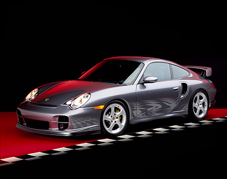 POR 04 RK0477 08 © Kimball Stock 2002 Porsche GT2 Gray 3/4 Side On Red Floor Checkered Line Studio