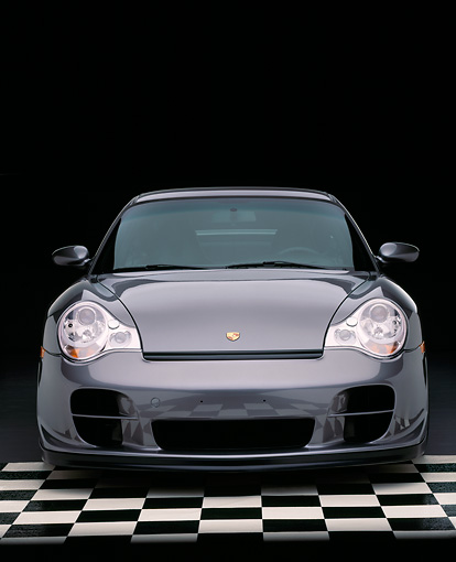 POR 04 RK0478 03 © Kimball Stock 2002 Porsche GT2 Gray Head On Shot On Checkered Floor Studio