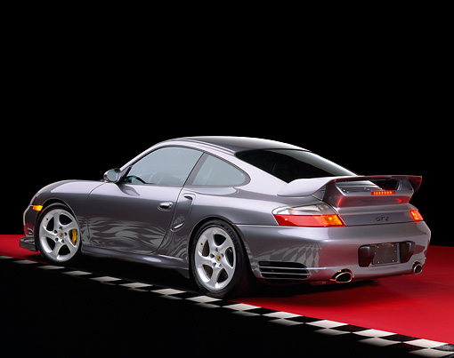 POR 04 RK0480 05 © Kimball Stock 2002 Porsche GT2 Gray 3/4 Rear View On Red Floor Checkered Line Studio