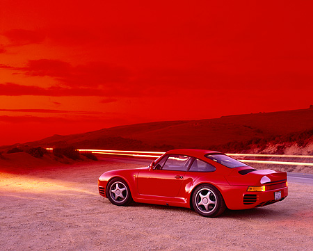 POR 04 RK0487 04 © Kimball Stock 1988 Porsche 959 Red 3/4 Rear View On Sand By Hills Filtered