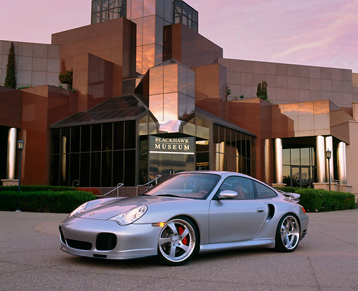 POR 04 RK0513 03 © Kimball Stock 2003 Porsche Turbo 911 Silver 3/4 Side View On Pavement By Museum