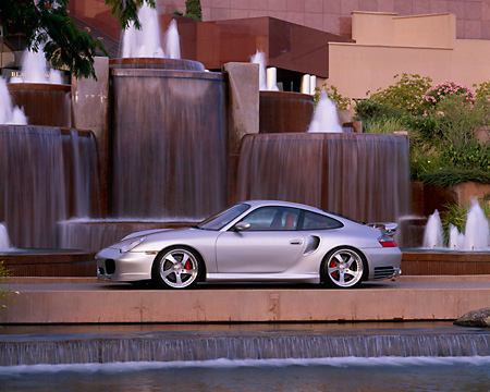 POR 04 RK0514 02 © Kimball Stock 2003 Porsche Turbo 911 Silver 3/4 Front View By Fountains