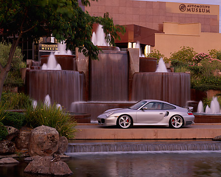 POR 04 RK0514 13 © Kimball Stock 2003 Porsche Turbo 911 Silver 3/4 Front View By Fountains