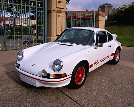 POR 04 RK0523 02 © Kimball Stock 1973 Porsche 911 Carrera RS White 3/4 Front View On Pavement By Gate