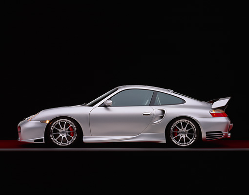POR 04 RK0550 04 © Kimball Stock 2004 Porsche X50 Turbo Silver Profile View On Red Floor Gray Line Studio